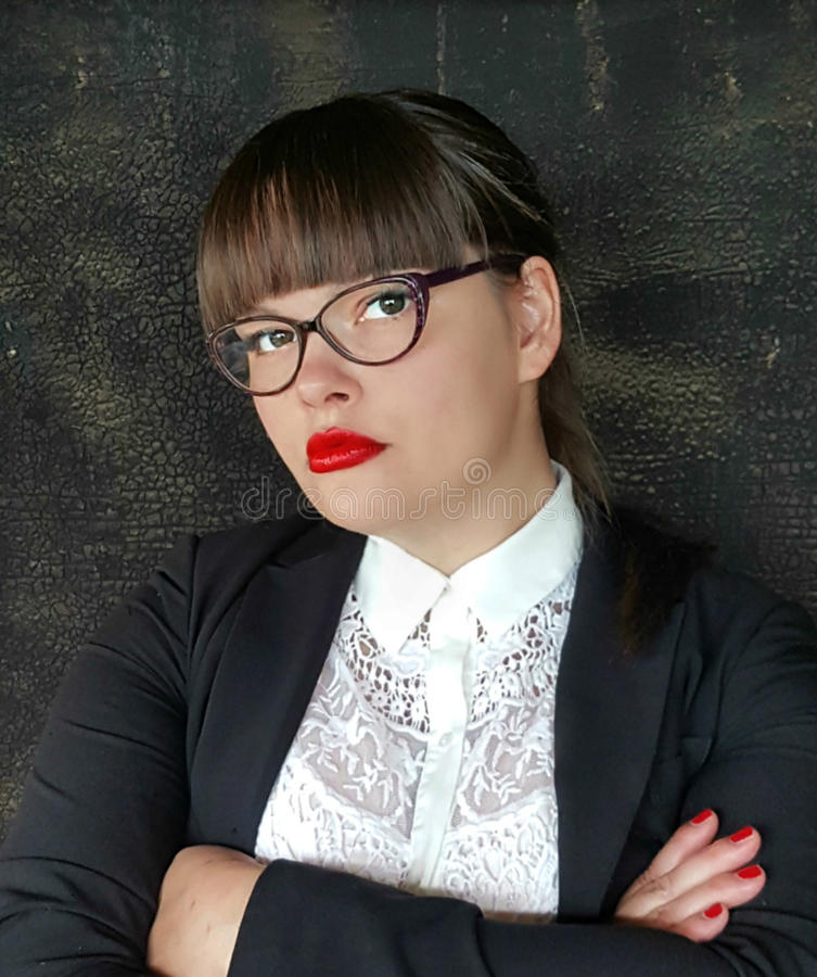 Powerful business woman. In glasses with arms crossed royalty free stock photos