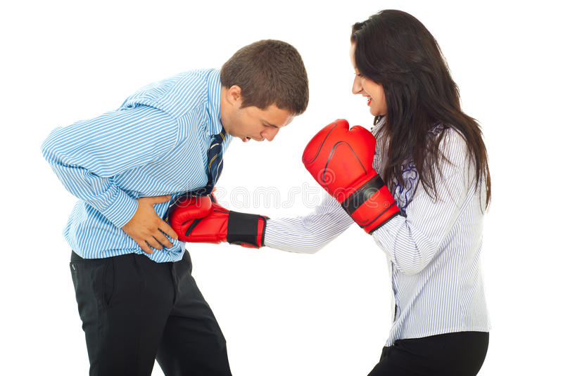 Powerful business woman hit man. Powerful business woman with boxing gloves hit stomach business man isolated on white background stock images