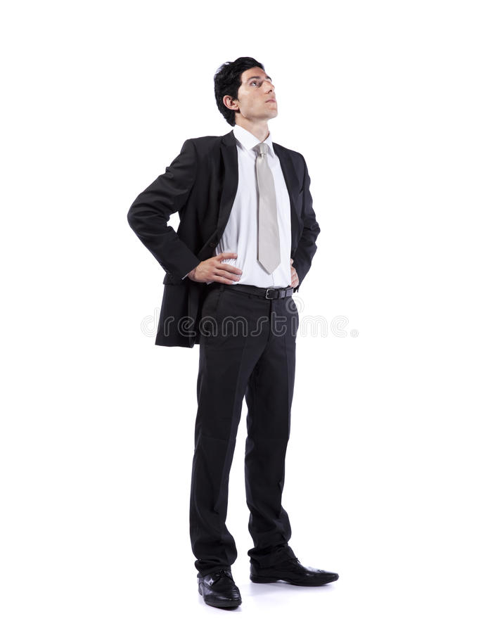 Powerful businessman looking up