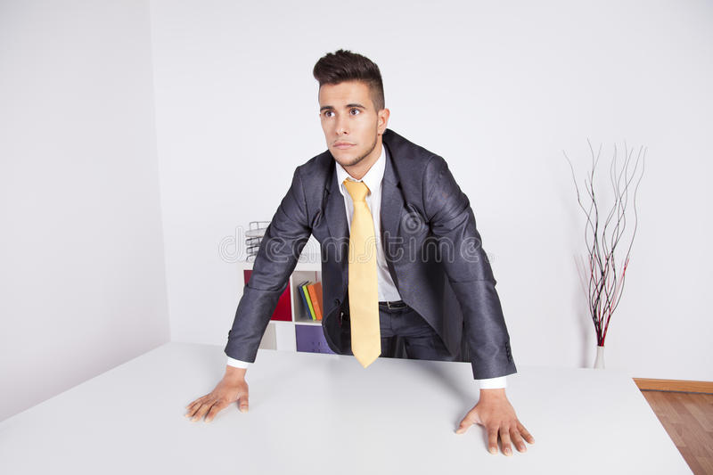 Powerful businessman at the office stock image