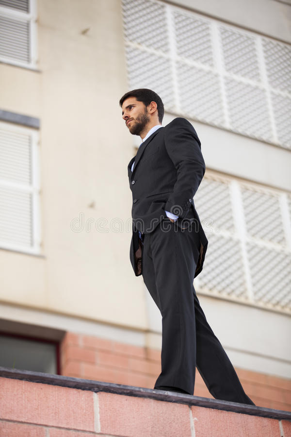 Powerful businessman at the roof stock images