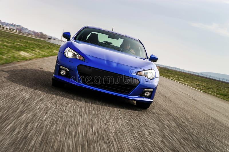 Powerful car on race way. Motion capture. Speed concept stock images