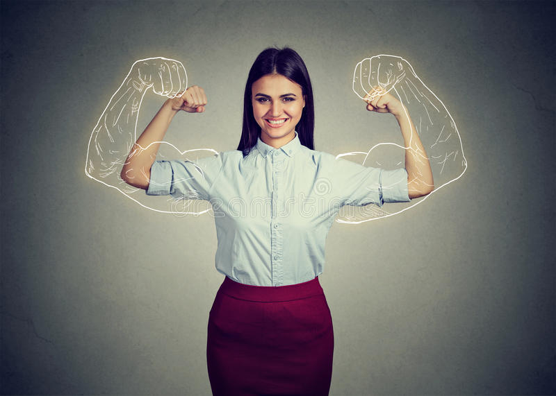 Powerful confident woman flexing her muscles. royalty free stock photos