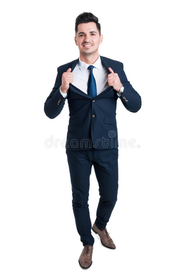 Powerful and confident young businessman opening his suit jacket stock images