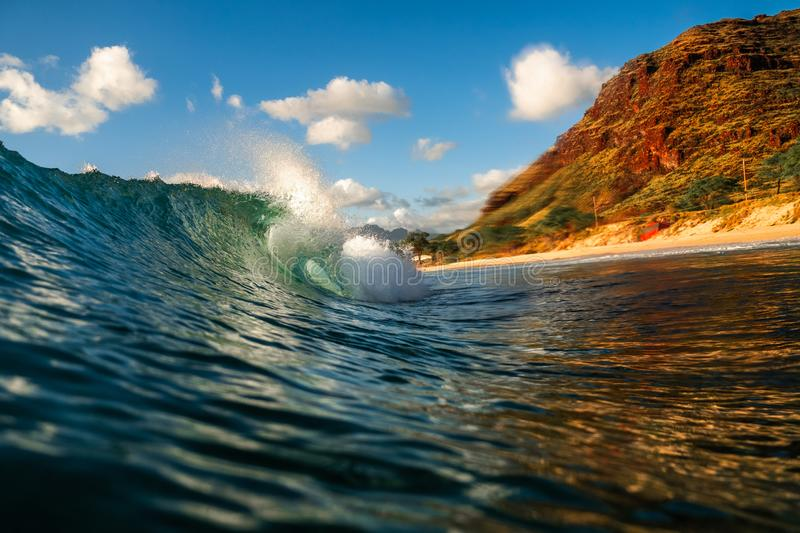 Powerful crystal clear ocean wave stock image