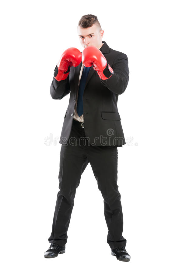 Powerful and determined business man. Wearing red boxing gloves and protecting his private company stock images