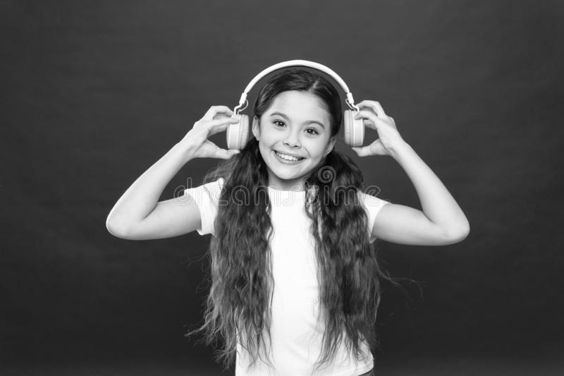 Powerful effect music teenagers their emotions, perception of world. Girl listen music headphones on red background. Modern gadget concept. Music taste. Music stock photos