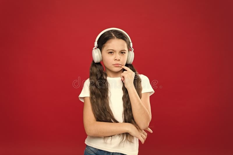 Powerful effect music teenagers their emotions, perception of world. Girl listen music headphones on red background. Play list concept. Music taste. Music royalty free stock photo