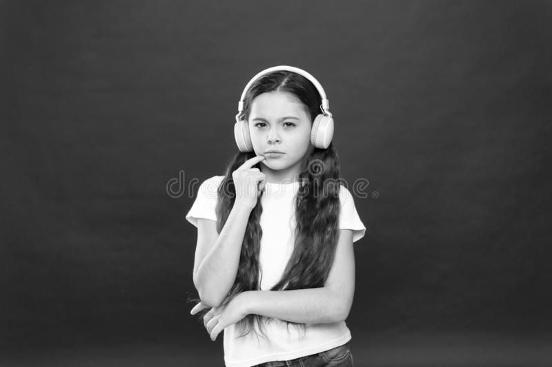 Powerful effect music teenagers their emotions, perception of world. Girl listen music headphones on red background. Play list concept. Music taste. Music royalty free stock image