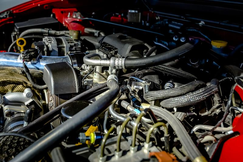 Powerful engine under the hood of a modern car stock image