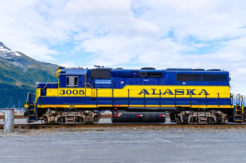 Freight train engine in Whittier, Alaska. Powerful freight train engine stationary at a railroad crossing in Whittier, Alaska, USA royalty free stock photography