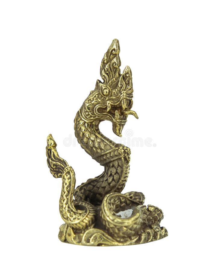 Powerful golden Naga amulet is the symbolic of disciple in Buddhism isolated white background. royalty free stock photos