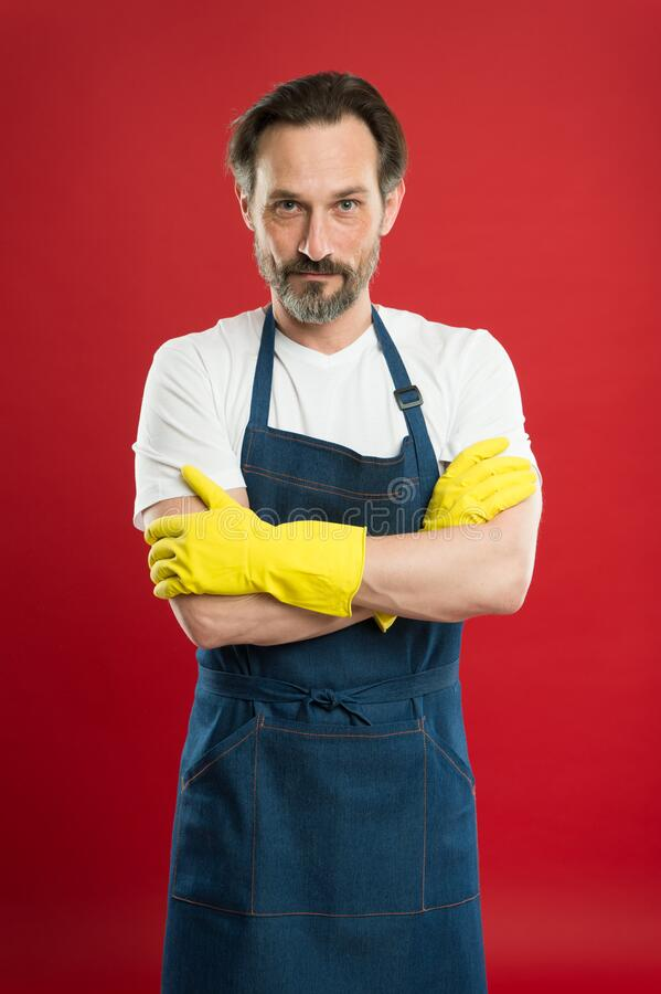 Powerful helper. On guard of cleanliness. Cleaning service and household duty. Lot of work. Man in apron with gloves. Cleaning. Cleaning day today. Bearded guy stock photos