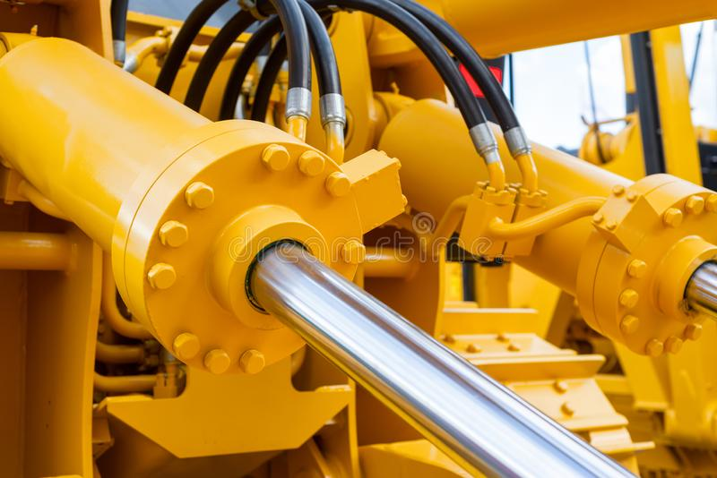 Powerful hydraulic cylinders. The main power and driving element for construction equipment.  stock photos