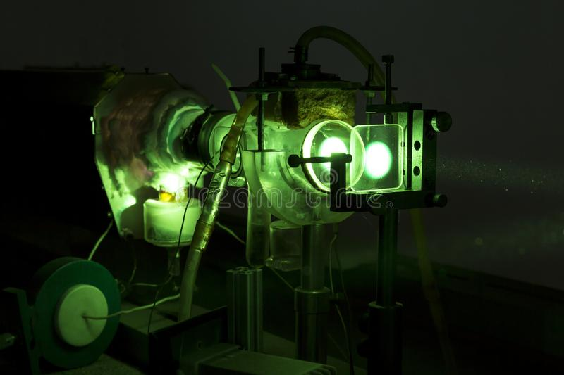 Powerful industrial green LASER for research. Powerful industrial green laser equipment in a laboratory for physics research. Solid State Physics lab. Light stock images