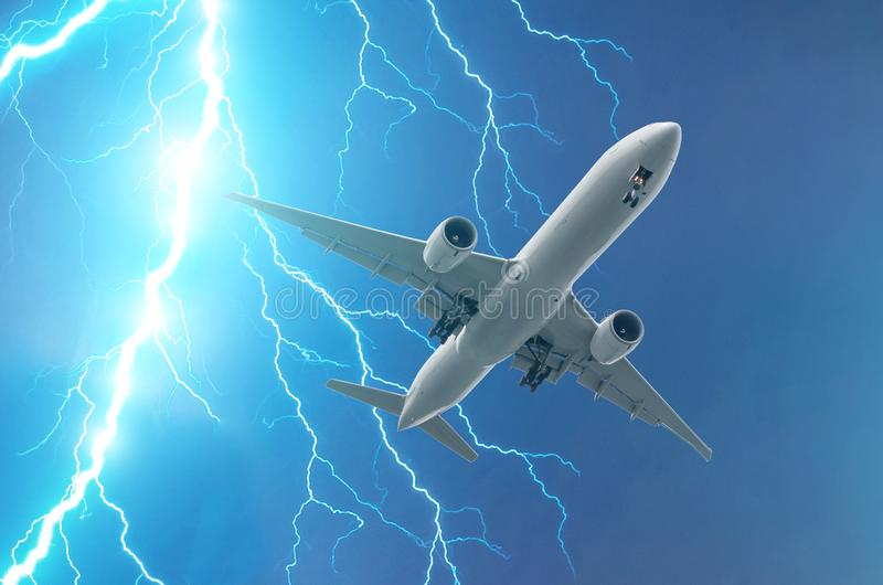 Powerful lightning strike in a thunderstorm near the plane.  stock image