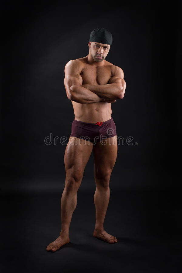 Powerful male bodybuilder showing his strong muscles royalty free stock photography