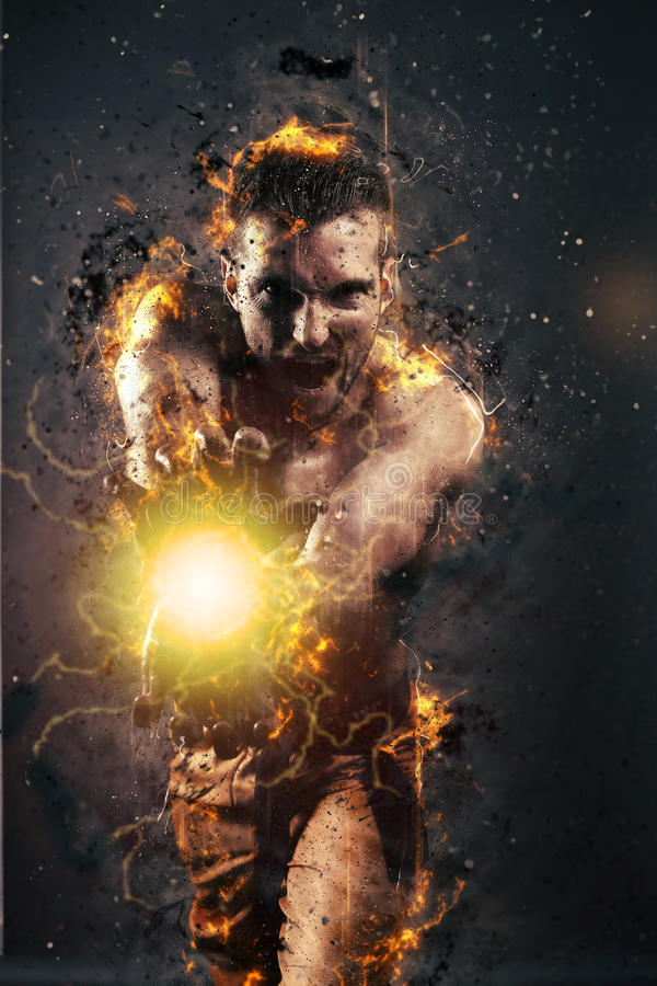 Powerful man creating an energy blast with his hands. Over a gray background royalty free stock photo