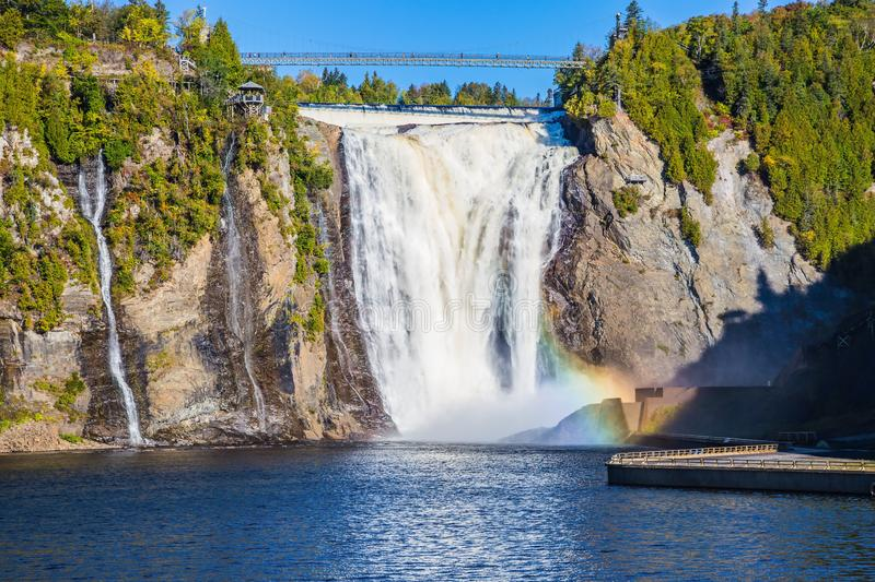 Powerful Montmorency. Powerful waterfall Montmorency in Montmorency Falls Park, close to the center of Old Quebec. Sunny autumn day. The concept of active and royalty free stock photography