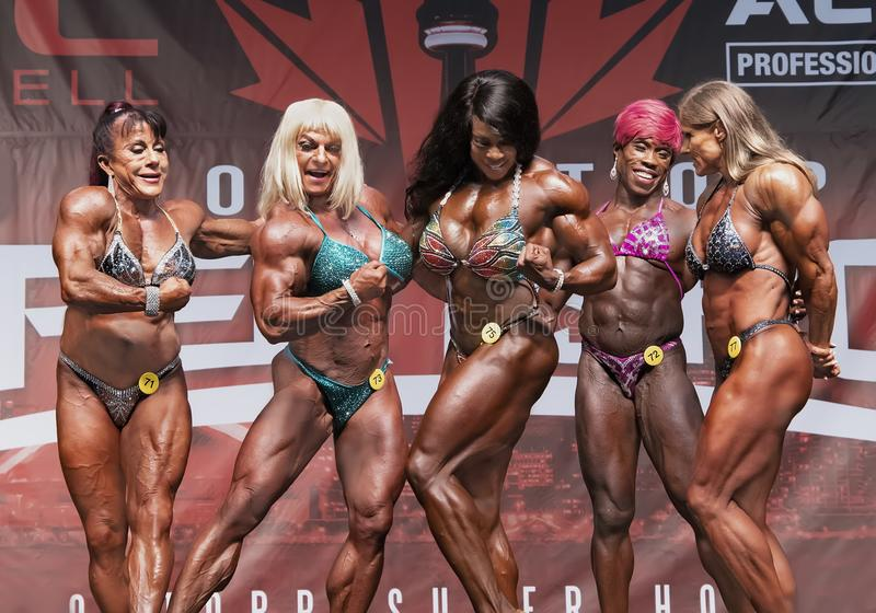 Powerful Muscle Women Posedown at 2018 Toronto Pro Supershow. Five powerful women posedown at the Women`s Pro Bodybuilding competition of the 2018 Toronto Pro stock images