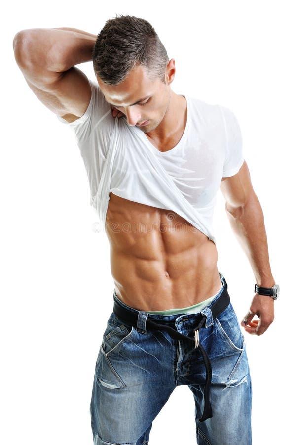 Powerful Muscular Man Posing Stock Photo