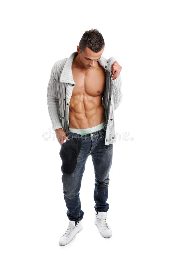 Powerful muscular man posing. On a white background stock photos