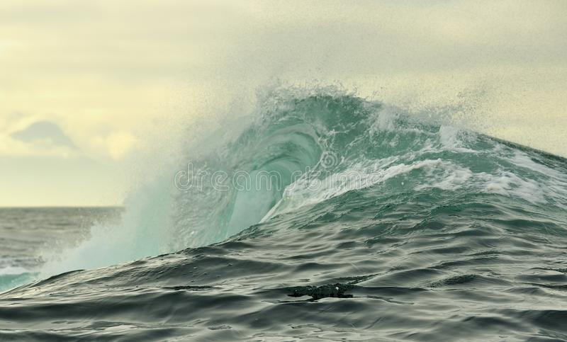 Powerful ocean wave breaking. Wave on the surface of the ocean. Wave breaks on a shallow bank. Natural background royalty free stock photos