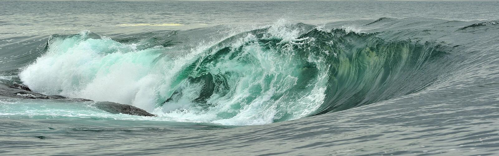Powerful ocean wave breaking. Wave on the surface of the ocean. Wave breaks on a shallow bank. Natural background stock photo