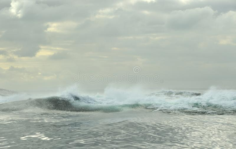 Powerful ocean waves breaking. Wave on the surface of the ocean. royalty free stock photo