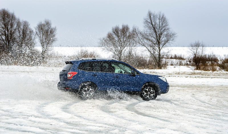 Powerful offroader car sliding by lake ice stock images