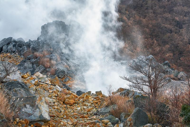 The sulfurous fumes of Owakudani  Valley.  Hakone area. Honshu. Japan. Powerful outbursts of fumes and sulfur among the rocks in the  Owakudani  Valley.  Hakone royalty free stock photography