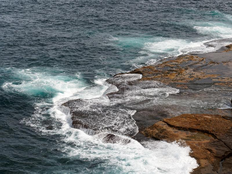 Powerful Pacific Ocean Waves Crashing on Rocks stock image