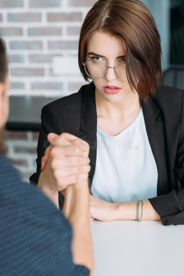 Powerful self sufficient ambitious woman feminism. Powerful, self sufficient woman. Ambition, motivation and success in career. Ladies against men in business stock photos