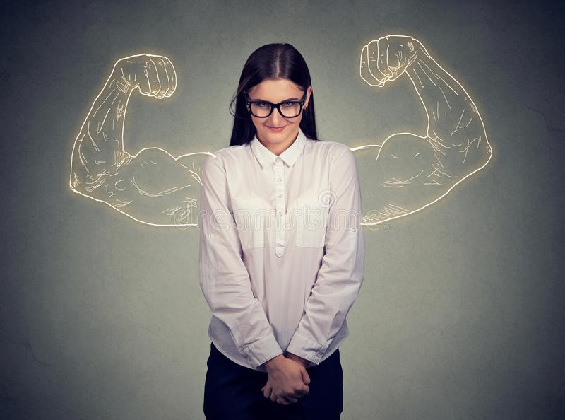 Powerful shy nerdy girl flexing muscles. Powerful shy nerdy girl strong inside royalty free stock images