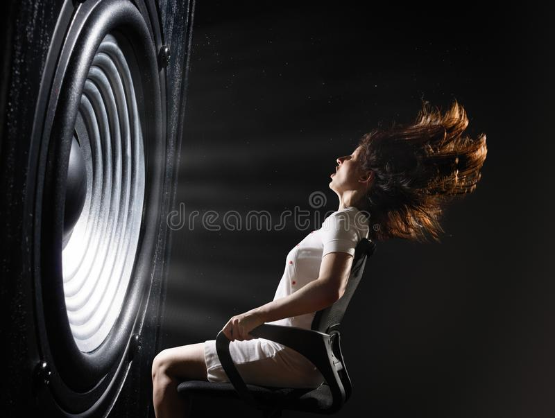 Powerful sound wave. The sound wave set back an office chair with young woman royalty free stock photo