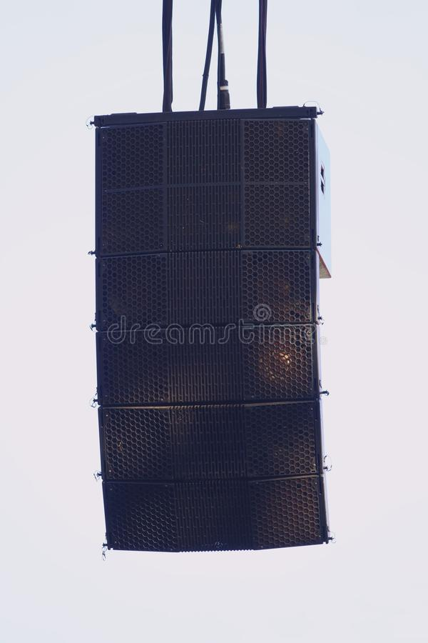 Powerful speakers set hanging over on the stage stock images