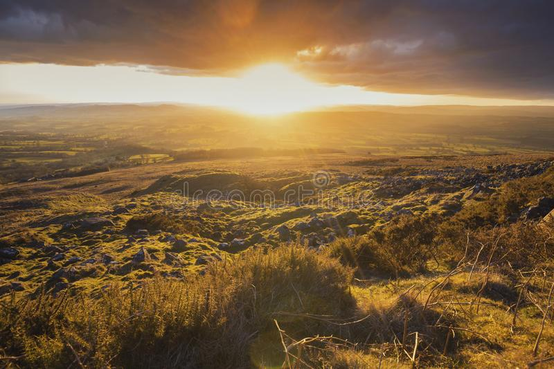 Powerful Sunset Light over British Countryside. Dramatic sunset light over scenic british countryside seeing from the slopes of Titterstone Clee Hill in royalty free stock photography