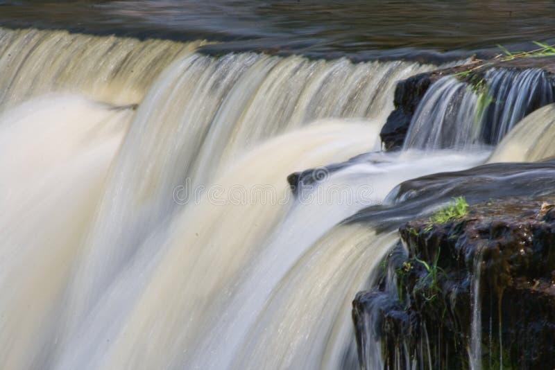 Powerful waterfall. Water cascading down Keila-Joa waterfall, Estonia royalty free stock image