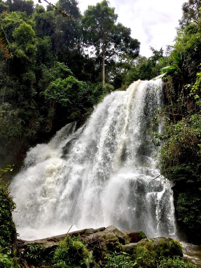 Cascading Waterfall in Thailand. A powerful waterfall surges through the jungle during he early afternoon stock images
