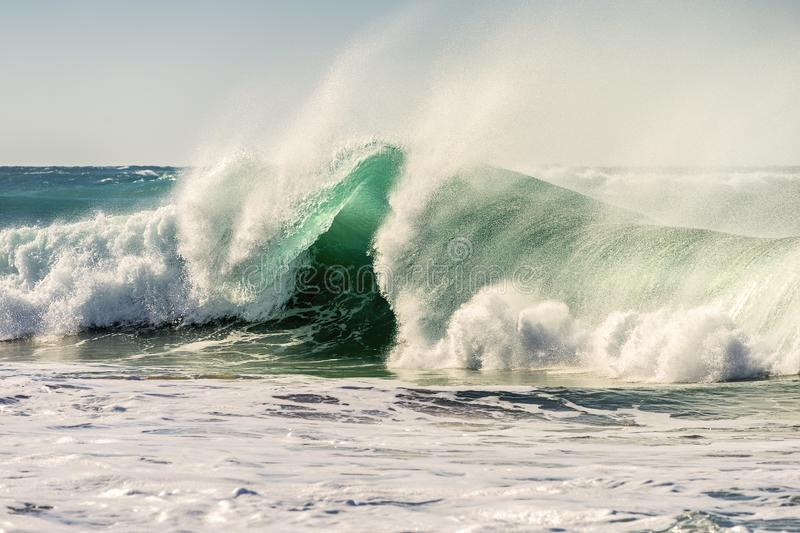 Spectacular wave breaking powerful among foam stock image