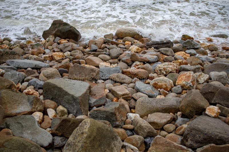 Powerful wave from sea with Rock on the beach before raining storm royalty free stock photo