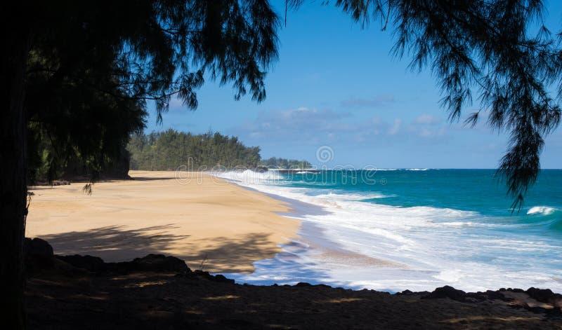 Powerful waves flow onto sand at Lumahai Beach, Kauai. Dramatic powerful waves crash onto sand on dangerous beach at Lumaha'i, Kauai, Hawaii stock image