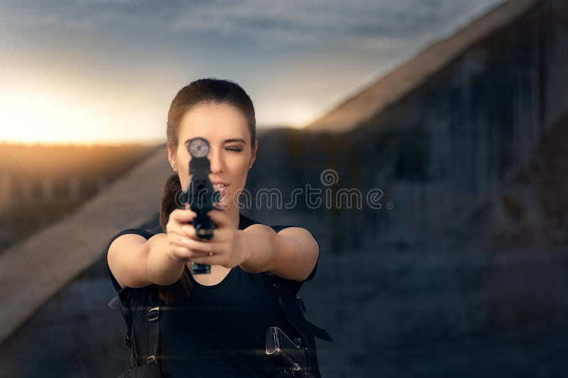 Powerful Woman Aiming Gun Action Movie Style stock images