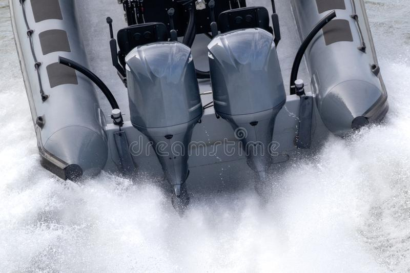 Outboard motors on a speed boat. Powerfull outboard engines mounted on a speed boat in action motor motors water fast motion sea sport transportation motorboat stock photography