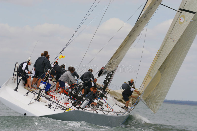 Powering Through. A fully crewed racing yacht sailing in a race