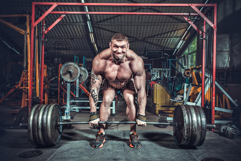 Powerlifter with strong arms lifting weights stock images