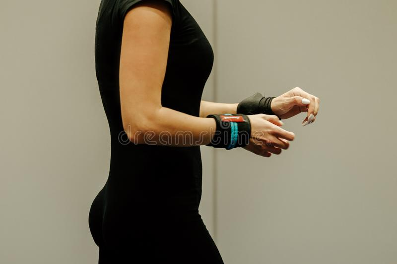 powerlifter woman with wrist wraps stock photo