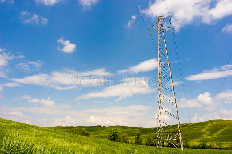 Powerline on Green Field. Powerline on a wide green field. Environment care stock image