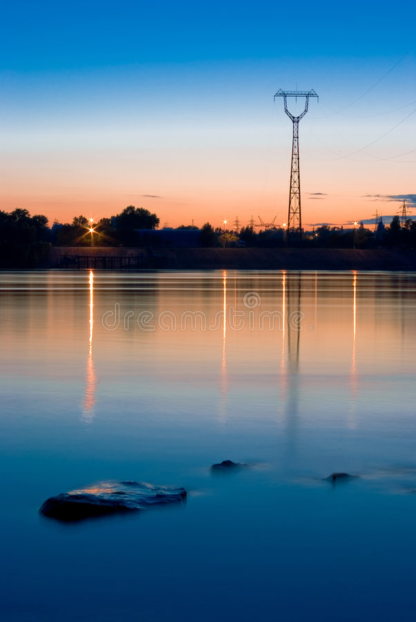 Powerline near the river stock images
