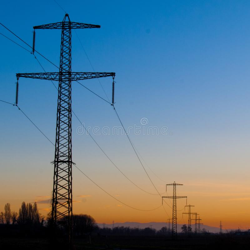 Powerline during sunset time stock photo